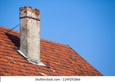 old chimney from the brick of a dilapidated house