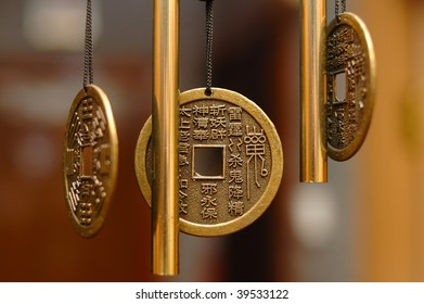 Old chinese bronze bell with hieroglyphs - on defocused (blurred) background.