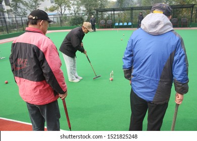 CHINA,BEIJING-‎November ‎03, ‎2016. Old chinese peoples playing gate ball game