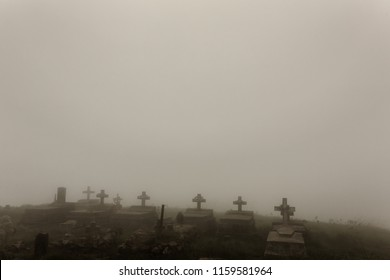Old christian cemetery with crosses. Monochrome photo with a copy space. Dark mood halloween concept