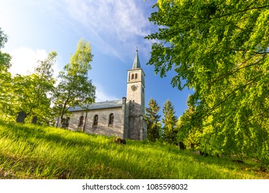 Old christian church and graveyard in the Wood and grass
