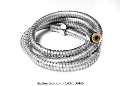 Old chrome water shower pipe with  hose isolated on white background,