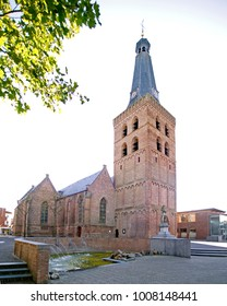 The Old Church in Barneveld, the Netherlands, with the statue of Jan van Schaffelaar in front of it.
