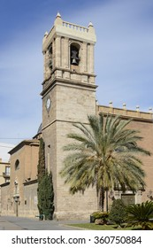 Old church with bell tower on main road leading to seafront and port in Valencia, Spain