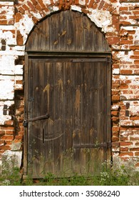 Old church closed entrance with wood door and lock