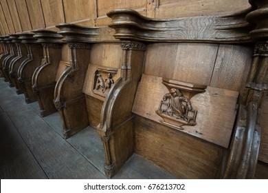 OLD CHURCH OR DE OUDE KERK, AMSTERDAM, THE NETHERLANDS - JULI 7, 2017: Old wooden misericords.