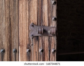 Old church door with ironwork and gloomy interior