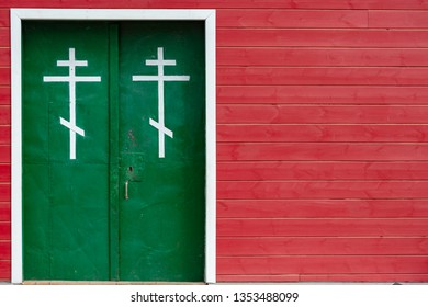 Old church entrance doors in Russia, Europe. Old architecture. Faith and religion.