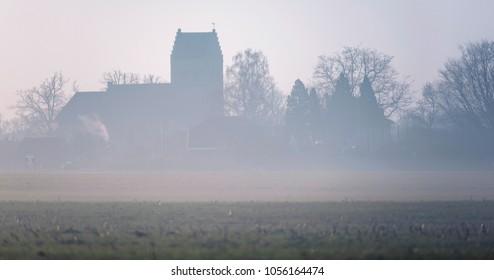 Old church in foggy dutch countryside. Geesteren, Achterhoek, Gelderland.