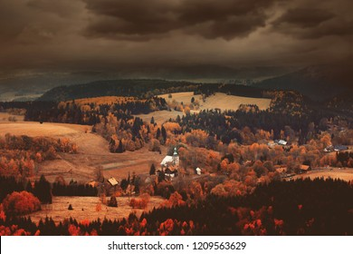 Old church in forest in autumn season time in South Poland, Beskidy mountains