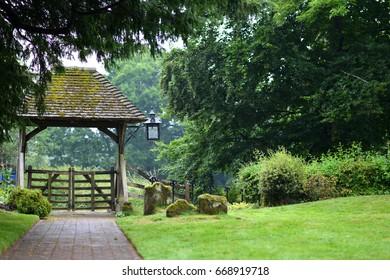 Old church lychgate and path n the rain
