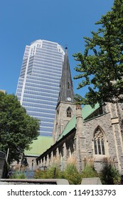 old church with modern skyscraper in Montreal, Canada