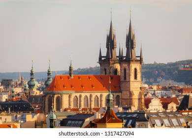 Old Church of Our Lady before Tyn in Prague. View from the park at the sunset.