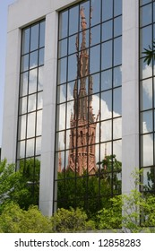 old church reflected in modern building