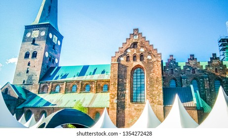 An old church in Scandinavian architectural style is located downtown of Aarhus, Denmark. Typical Danish architecture in Aarhus, a famous city on the east coast of Jutland region in Denmark.
