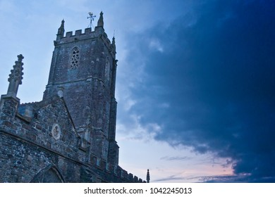 Old church (St Mary Magdalene church, South Molton, Devon) in the evening with a very dark sky approaching. A threat of rain or it can be used for horror stories.