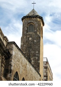 old church tower in Jerusalem against the sky
