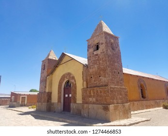 Old church in a village in South America, constructed with clay bricks and mud. blue sky