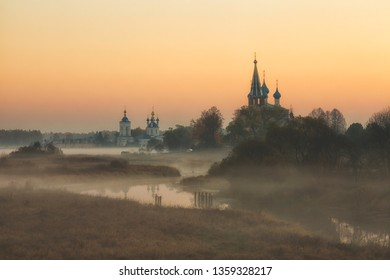 old churches  at  sunrise in Dunilovo, Russia