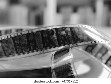 Old cine-film. Film strip on a blur background. Black and white photo.