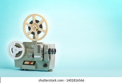 Old cinema projector on blue background