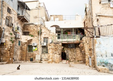 Old City of Acre, Israel - December 27, 2018: Exterior of Old neglected shabby house buildings in Old City of Acre (Akko) in Israel, Middle East.