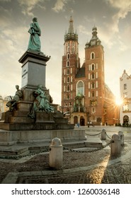 Old city center view with Adam Mickiewicz monument and St. Mary's church in Krakow