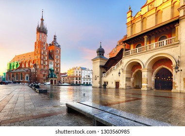 Old city center view with Adam Mickiewicz monument and St. Mary's Basilica in Krakow on the morning