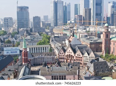 Old city of Frankfurt with tall modern skyscrapers on background
