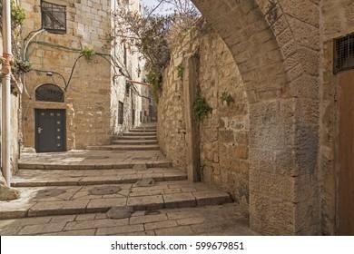 Old city hidden passageway, stairway and arch in jewish quarter. Jerusalem, Israel