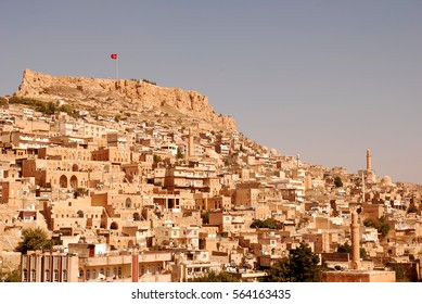 Old city of Mardin and castle with Turkish flag