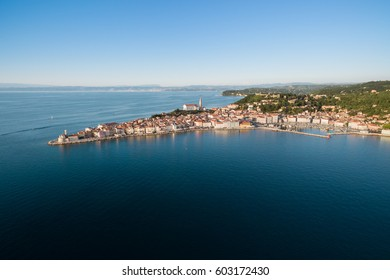 Old city Piran in Slovenia, bird's eye view at sunset. Aerial photo.