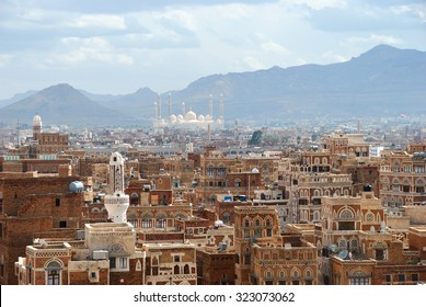 Old city of Sanaa the capital of Yemen. View on the city from roof at sunrise