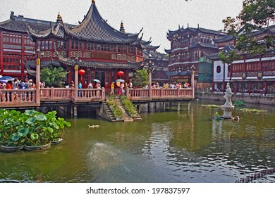 old city in Shanghai with restored houses and a pond, stylized and filtered to resemble an oil painting.