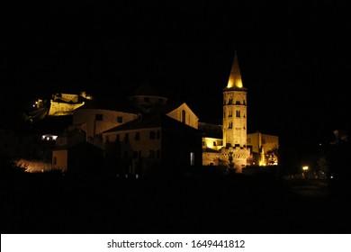 Old city sleep at night under the faint glow of lanterns.