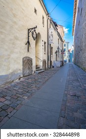 Old City of Talinn, Estonia-September 30, 2015: Medieval, mystic streets, cobbled streets, preserved, colorful buildings and streets, authentic architecture with many gourmet restaurants and cafes