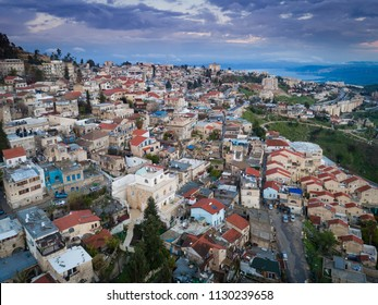 The old city of Tzfat in Northern Israel with the Galilee Sea in the background
