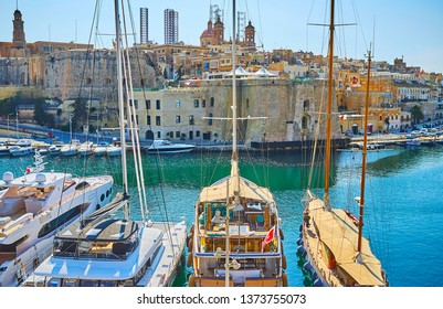 The old city wall of Birgu is perfect place to observe ychts in Vittoriosa marina and medieval fortifications of Senglea, such as St Michael and Sheer Bastions, Malta.