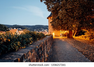 Old city wall with tower in the evening in Wernigerode