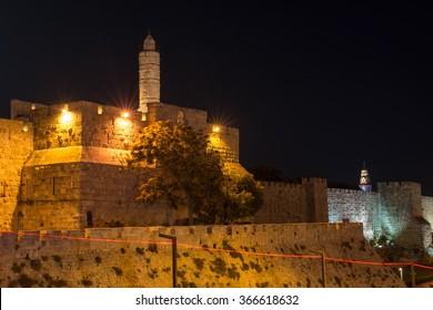 the old city walls of Jerusalem at night