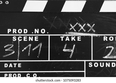 old  clapperboard labeled with chalk