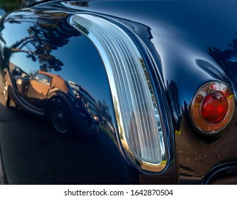 Old classic car   reflected in the bodywork of another classica car