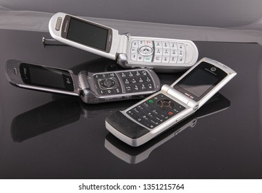 Old Classic Flip Style Cell Phones on Black