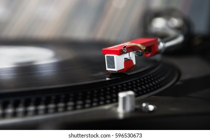 Old classic hifi vinyl records player.Turntable record on retro hipster music player.Vintage technology to play vinyl disc,listen to music.Hifi audio equipment for sound enthusiast.Turntables needle