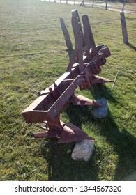 Old and classic plow. Smooth drag equipment for agriculture. Traction tool for the tractor. Field work. Equipment to till the ground. Rural scene. Inter row crop plough, agricultural machinery.