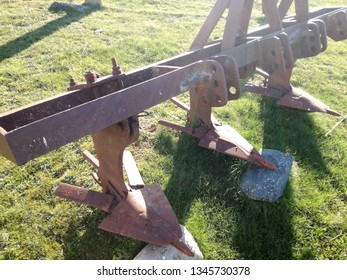 Old and classic plow. Smooth drag equipment for agriculture. Traction tool for the tractor.
