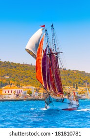 Old classic wooden boat with red sails, during a Classic Boats Regatta in Spetses island in Greece