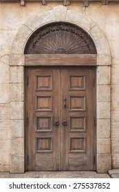 Old classic wooden door in Italy