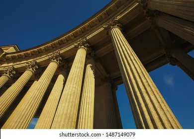 Old classical architecture concept. Vintage columns with decorative elements of Kazan Cathedral in Saint Petersburg under blue sky. Text space. Outdoor shot