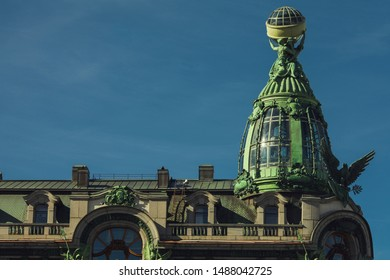 Old classical architecture concept. Vintage roof with glass dome and decorative elements of famous house in Saint Petersburg's centre. Text space. Outdoor shot